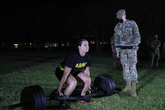 """U.S. Army Reserve Spc. Arianna Hammel, an Intelligence Analyst with the 310th Psychological Operations Company (Airborne), prepares to conduct the deadlift event of the Army Combat Fitness Test (ACFT) at Ft. Jackson, S.C. Hammel is competing for the title """"Soldier of the Year"""" in the 2021 U.S. Army Civil Affairs and Psychological Operations Command (Airborne) Best Warrior Competition April 8 - 11, 2021. The USACAPOC(A) BWC is an annual competition that brings Soldiers from across the command to compete for the title of """"Best Warrior."""" BWC is designed to test each Soldiers' mental and physical resilience as they adapt and overcome each scenario or task placed before them."""