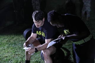 """U.S. Army Reserve Staff Sgt. Riley Greenwald, 432nd Civil Affairs Bn., and Staff Sgt. Valery Valtrain, 151st Theater Information Group, check the scoring breakdown of the Army Combat Fitness Test (ACFT) prior to their participation in the event conducted at Ft. Jackson, S.C. Hammel and Valtrain are competing against Soldiers from across the U.S. Army Civil Affairs and Psychological Operations Command (Airborne) command for the title """"NCO of the Year"""" at the 2021 USACAPOC(A) Best Warrior Competition April 8 - 11, 2021. The USACAPOC(A) BWC is an annual competition that brings Soldiers from across the command to compete for the title of """"Best Warrior."""" BWC is designed to test each Soldiers' mental and physical resilience as they adapt and overcome each scenario or task placed before them."""