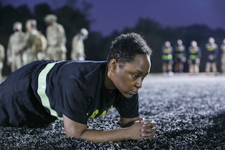 """U.S. Army Reserve Staff Sgt. Valery Valtrain, 151st Theater Information Operations Group, conducts the plank alternate event while participating in the Army Combat Fitness Test conducted at Ft. Jackson, S.C. Valtrain successfuly maxed out at four minutes, 20 seconds. Valtrain is competing for the title """"NCO of the Year"""" in the 2021 U.S. Army Civil Affairs and Psychological Operations Command (Airborne) Best Warrior Competition April 8 - 11, 2021. The USACAPOC(A) BWC is an annual competition that brings Soldiers from across the command to compete for the title of """"Best Warrior."""" BWC is designed to test each Soldiers' mental and physical resilience as they adapt and overcome each scenario or task placed before them."""
