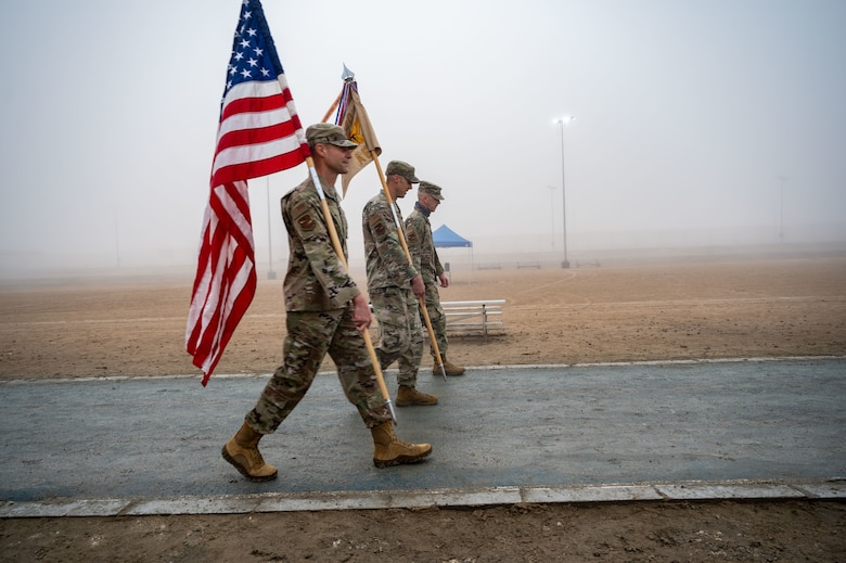 Brig. Gen. Larry Broadwell, Chief Master Sgt. Joshua Wiener and  Col. Jeremy Reeves walk for a Holocaust Days of Remembrance event.