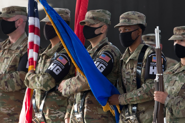 U.S. Air Force Honor Guardsmen assigned to the 380th Air Expeditionary Wing perform the presentation of the colors