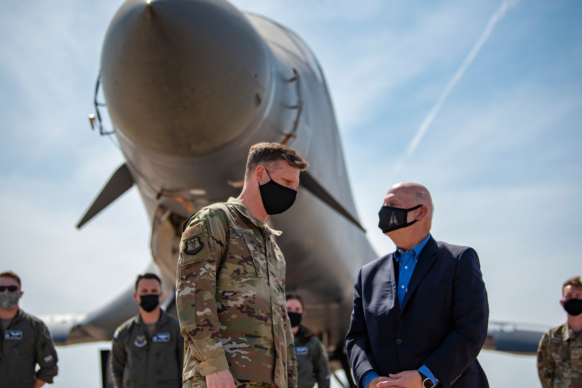 Col. James Young, 317th Airlift Wing commander, talks with Acting Secretary of the Air Force John Roth on the flightline at Dyess Air Force Base, Texas, April 6, 2020. During the visit, Dyess Airmen highlighted the B-1's global strike ability while showcasing the 317th AW and how they are leading the way for tactical airlift capabilities. (U.S. Air Force photo by Airman 1st Class Colin Hollowell)