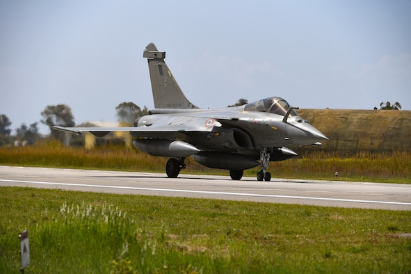 A French air force Rafale aircraft taxis on the runway at Andravida Air Base, Greece, April 7, 2021. The French air force arrived in Greece to participate in INIOCHOS 21. In addition to enhancing combat readiness and strengthening bonds, INIOCHOS provides participants the opportunity for developing capabilities in planning and conducting complex air operations in a multinational joint forces environment, leading to an advanced level of training for all participants. (U.S. Air Force photo by Airman 1st Class Thomas S. Keisler IV)