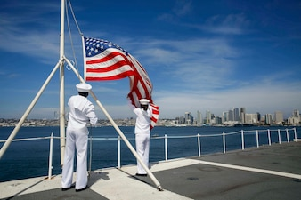 USS Abraham Lincoln (CVN 72) shifts colors in San Diego.