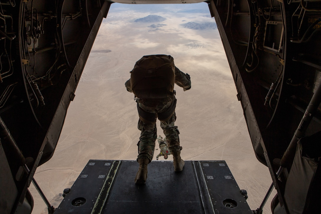 U.S. Army Soldiers assigned to 10th Special Forces Group (Airborne) jump out of an MV-22B Osprey helicopter with Marine Medium Tiltrotor Squadron (VMM) 365 at Marine Air-Ground Combat Center, California, April 1, 2021. Marines with Marine Medium Tiltrotor Squadron 365 and Soldiers with 10th SFG (A) prepare for future conflicts in the integrated and joint environment provided by Service Level Training Exercise (SLTE) 3-21. SLTE is a series of exercises designed to train Marines for operations around the globe by increasing their ability to operate and conduct offensive and defensive combat operations. VMM-365 is a subordinate unit of 2nd Marine Aircraft Wing, the aviation combat element of II Marine Expeditionary Force. (U.S. Marine Corps photo by Lance Cpl. Elias E. Pimentel III) (U.S. Marine Corps photo by Lance Cpl. Elias E. Pimentel III)