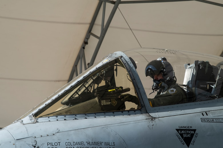 A photo of an Airman siting in an A-10C Thunderbolt II.
