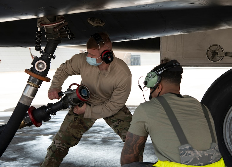 Airmen from the 28th Aircraft Maintenance Squadron prepare to fuel a B-1B Lancer at Ellsworth Air Force Base, S.D., April 5, 2021, in preparation for a Bomber Task Force mission.