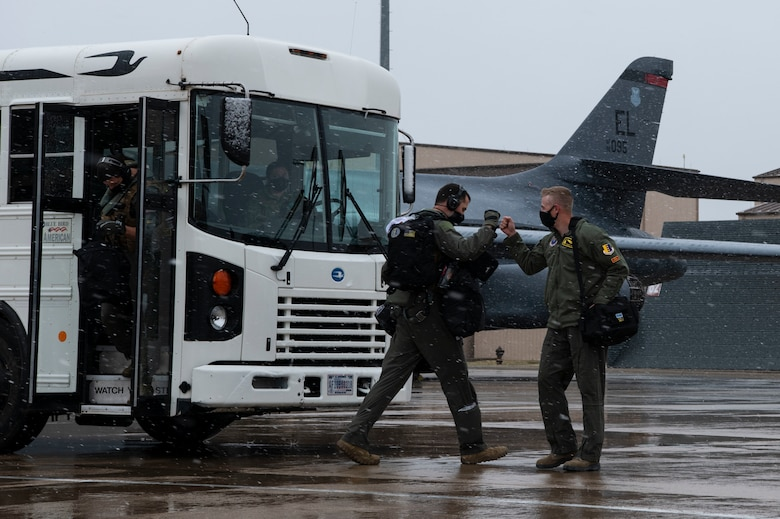 Aviators from the 37th Bomb Squadron greet each other before the start of a Bomber Task Force mission at Ellsworth Air Force Base, S.D., April 6, 2021.