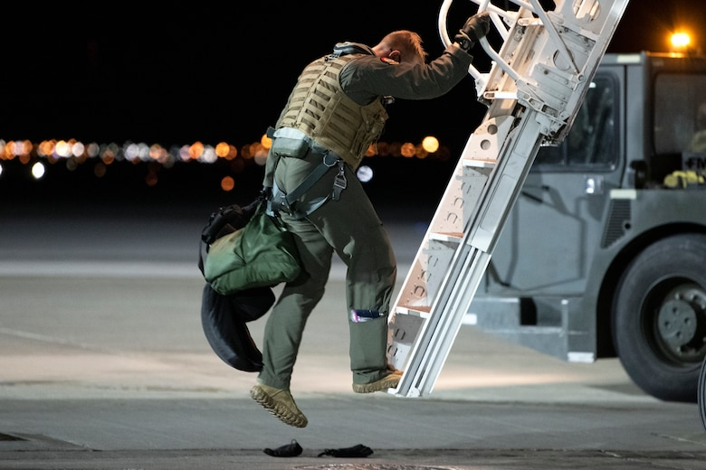 An aviator from the 37th Bomb Squadron steps down from a B-1B Lancer after returning from a Bomber Task Force mission at Ellsworth Air Force Base, S.D., April 7, 2021.