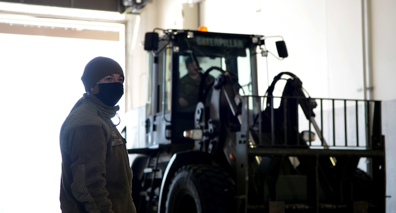 U.S Air Force Airman Destiny Nevis, a 354th Logistics Readiness Squadron Fuels Distrobution operator, directs a forklift during Arctic Gold (AG) 21-1 April 6, 2021, on Eielson Air Force Base, Alaska. During AG 21-2, the 354th LRS is responsible for receiving, weighing, securing and loading cargo for the deploying units. (U.S. Air Force photo by Senior Airman Beaux Hebert)