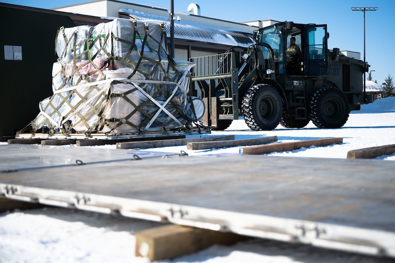 U.S. Air Force Airman 1st Class Cambrin Dixon, a 354th Logistics Readiness Squadron vehicle operator, picks up a cargo using a forklift during Arctic Gold 21-2 on Eielson Air Force Base, Alaska, April 6, 2021. AG 21-2 is a readiness exercise demonstrating the 354th Fighter Wing's ability to generate F-35A Lightning II aircraft and deploy forces and cargo from across the wing. (U.S. Air Force photo by Airman 1st Class Jose Miguel T. Tamondong)