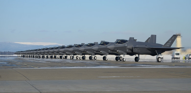 Twenty-five F-35A Lightning IIs assigned to the 354th Fighter Wing prepare to launch during Arctic Gold 21-2 April 7, 2021, on Eielson Air Force Base, Alaska. This exercise will evaluate the 354th Fighter Wing's ability to effectively generate F-35A Lightning II aircraft and deploy personnel and cargo from across the wing. (U.S. Air Force photo by Senior Airman Beaux Hebert)