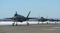 F-35A Lightning IIs assigned to the 354th Fighter Wing taxi on the flightline during Arctic Gold 21-2 April 7, 2021, on Eielson Air Force Base, Alaska. In addition to launching more than a dozen F-35As, the 354th Fighter Wing practiced processing and simulated deploying all required cargo for the aircraft. (U.S. Air Force photo by Senior Airman Beaux Hebert)