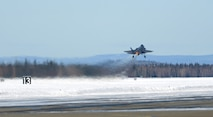 An F-35A Lightning II assigned to the 354th Fighter Wing takes off during Arctic Gold 21-2April 7, 2021, on Eielson Air Force Base, Alaska. As part of the exercise, the wing generated 25 F-35As and their cargo for deployment. (U.S. Air Force photo by Senior Airman Beaux Hebert)