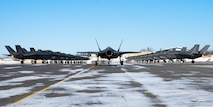 Twenty five F-35A Lightning IIs assigned to the 354th Fighter Wing assemble on the flightline prior to taking off during Arctic Gold (AG) 21-2 at Eielson Air Force Base, Alaska, April 7, 2021. AG 21-2 is a Phase I and Phase II readiness exercise designed to test the wing's ability to rapidly generate and deploy F-35A Lightning II aircraft, cargo and supporting personnel. (U.S. Air Force photo by Airman 1st Class Jose Miguel T. Tamondong)