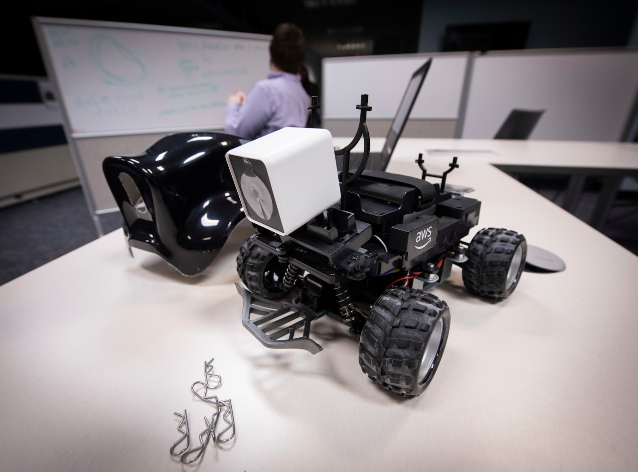 A small ground vehicle sits on desk.
