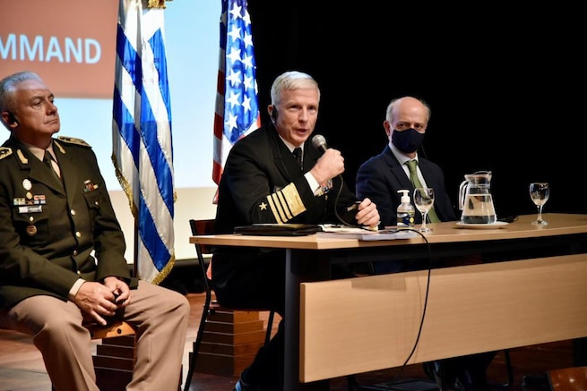 U.S. Southern Command's commander, Navy Adm. Craig Faller, speaks during a roundtable discussion with Uruguayan military personnel who have received training in the United States.