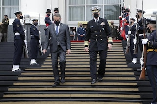 U.S. Southern Command's commander, Navy Adm. Craig Faller, and Argentine Minister of Defense Agustin Rossi depart the Libertador Building following a bilateral meeting with senior defense leaders to discuss security cooperation.