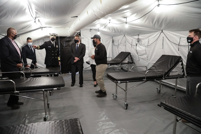 U.S. Southern Command's commander, Navy Adm. Craig Faller, and Argentine Minister of Defense Agustin Rossi, tour one of three mobile hospitals donated by the United States to Argentina.