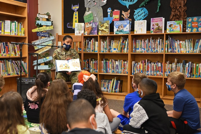 U.S. Air Force Col. Lauren Byrd, 17th Medical Group commander, reads to students at Glenmore Elementary, in partnership with San Angelo READS! and Month of the Military Child, in San Angelo, Texas, April 7, 2021. Byrd paused when reading the story to emphasize the importance of literacy and welcoming new students into the classroom. (U.S. Air Force photo by Senior Airman Abbey Rieves)