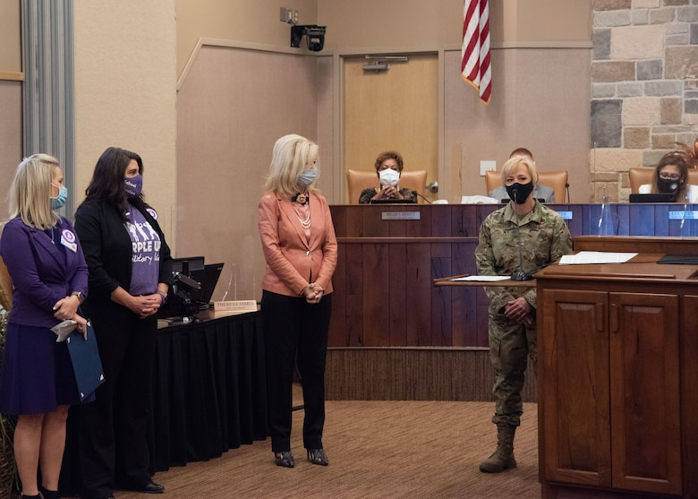 Chief Master Sgt. Casy Boomershine, 17th Training Wing command chief, provides remarks to the Mayor of San Angelo, Brenda Gunter, center, and the City Council at the proclamation singing event for the Month of the Military Child, during a monthly City Council meeting, April 6, 2021, at the McNease Convention Center in San Angelo, Texas. During the event, Gunter, proclaimed a city-wide recognition of April as the Month of the Military Child. (U.S. Air Force photo by Staff Sgt. Tyrell Hall)