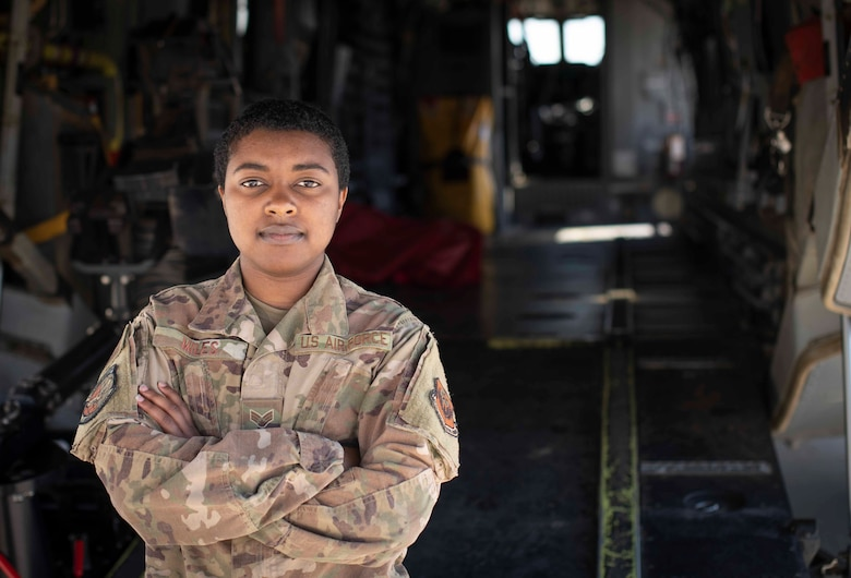 U.S. Air Force Senior Airman Nina Miles, a weapons load crew member with the 801st Special Operations Aircraft Maintenance Squadron, stands in front of a CV-22B Osprey at Hurlburt Field, Florida, Mar. 12, 2021.