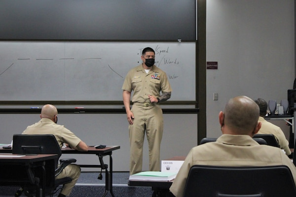 PORT HUENEME, Calif. (April 1, 2021) Seabee Master Chief Angel Cano, Civil Engineer Corps Officers School instructor, addresses the recently piloted Naval Construction Force Chief Petty Officer Leadership Course.  The Naval Construction Force Chief Petty Officer Leadership Course is a facilitated instructor-led training course for all active and reserve component chief petty officers assigned to the Naval Construction Force.  (U.S. Navy photo by Amber Vaglica)