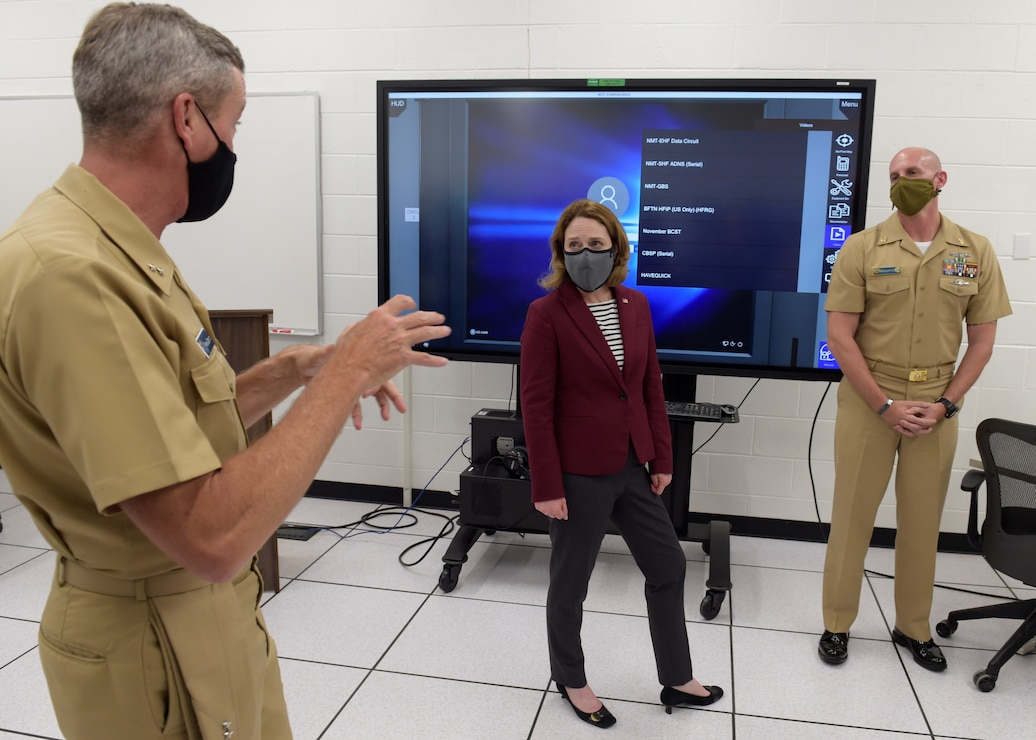 Deputy Secretary of Defense Kathleen H. Hicks participates in a Multipurpose Reconfigurable Training System 3D® (MRTS 3D®) technology training device demonstration and discussion with Rear Adm. Pete Garvin
