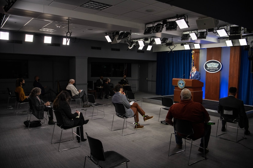 Man briefs reporters.