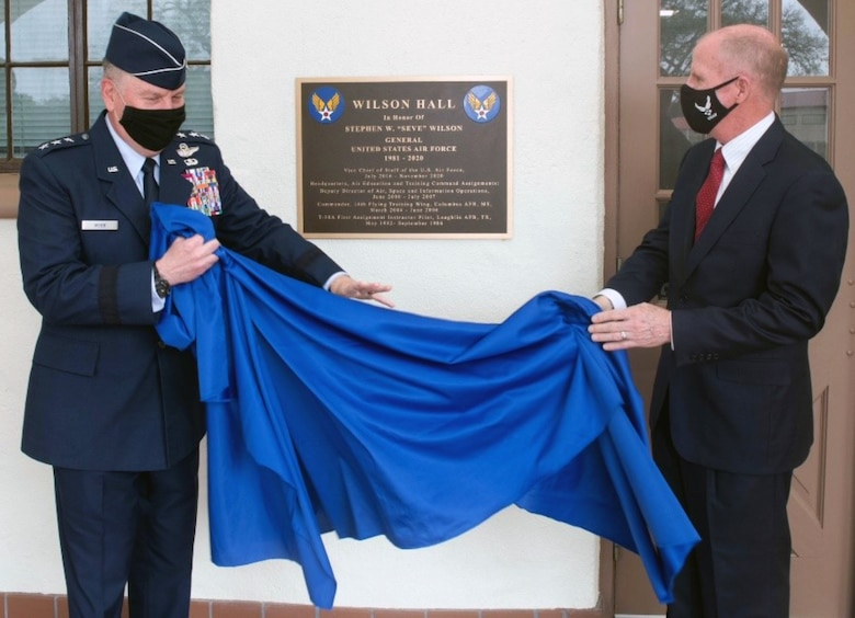 U.S. Air Force Lt. Gen. Brad Webb (left), commander of Air Education and Training Command, and retired Gen. Stephen Wilson (right), former Vice Chief of Staff of the Air Force, unveil the Wilson Hall dedication plaque April 9 at Joint Base San Antonio-Randolph. Wilson's career began in AETC as a student pilot at Laughlin Air Force Base, Texas, followed by an assignment as a T-38 Talon instructor pilot there.