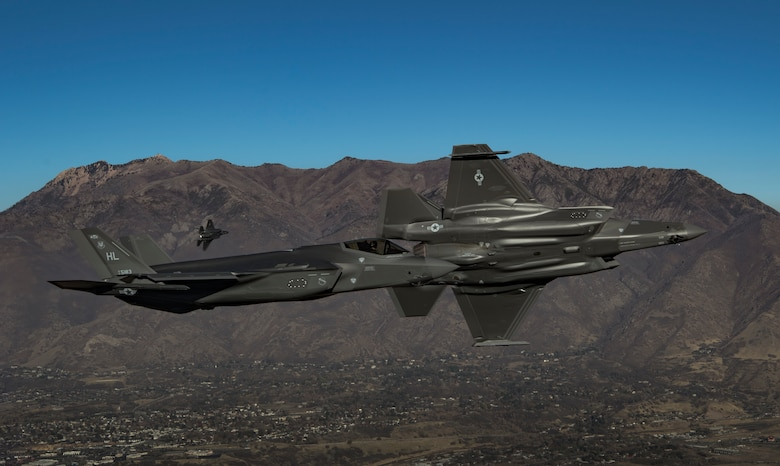A photo of two F-35s