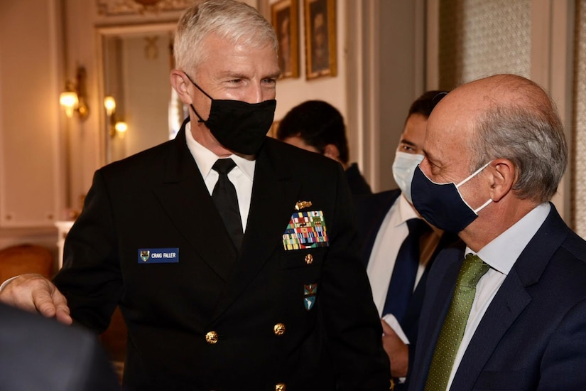 U.S. Southern Command's commander, Navy Adm. Craig Faller, speaks with Uruguayan Minister of National Defense Javier Garcia.