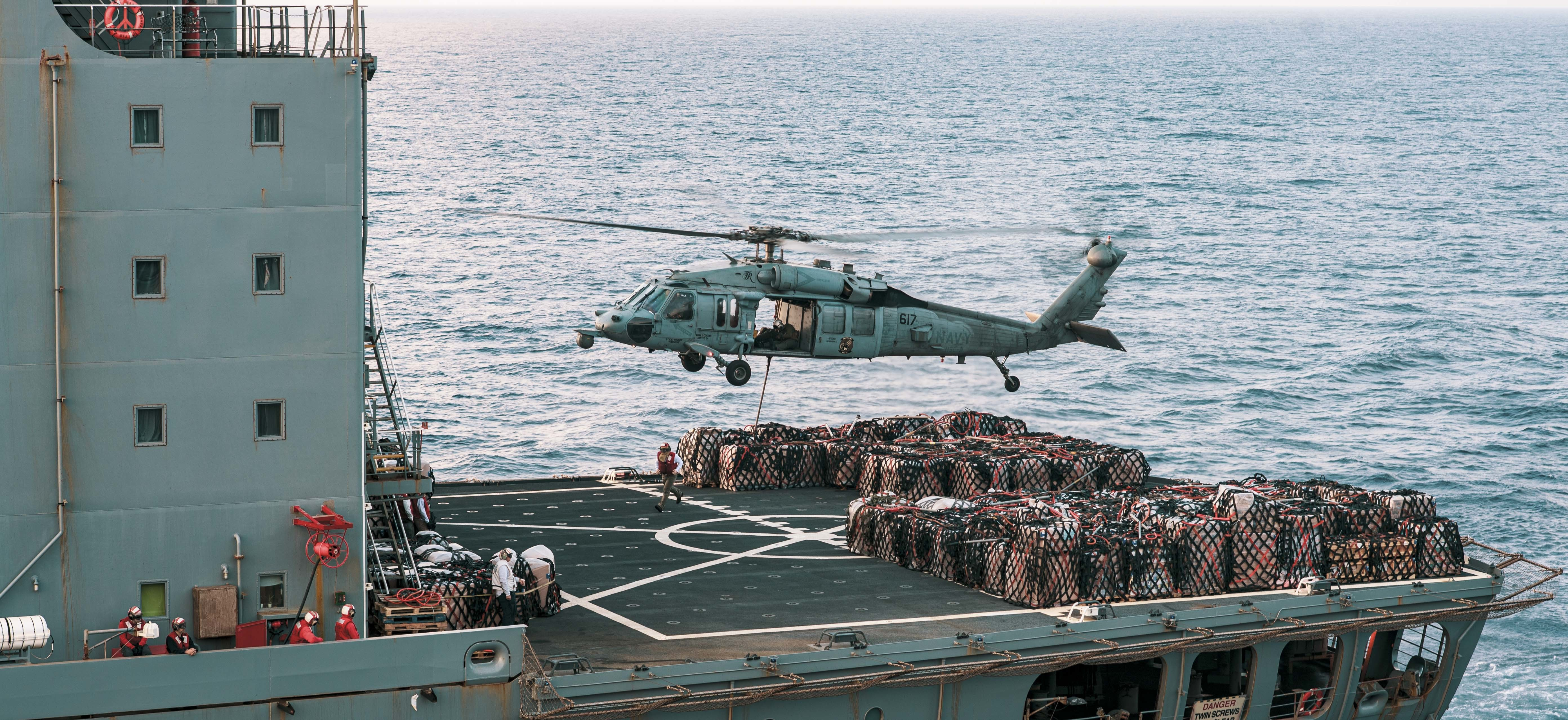 An MH-60S Sea Hawk lifts supplies from the fleet replenishment oiler USNS Guadalupe (T-AO 200) during a replenishment-at-sea with the aircraft carrier USS Theodore Roosevelt (CVN 71) April 8.