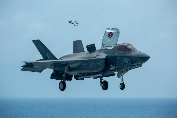 U.S. Marine Corps F-35B Lightning IIs assigned to Marine Medium Tiltrotor Squadron 164 (Reinforced), 15th Marine Expeditionary Unit, land on the flight deck of the amphibious assault ship USS Makin Island (LHD 8). The Makin Island Amphibious Ready Group and embarked 15th MEU are operating in the U.S. 7th Fleet area of operations to enhance interoperability with allies and partners and serve as a ready response force to defend peace and stability in the Indo-Pacific region.