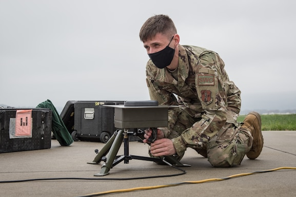 U.S. Air Force Staff Sgt. Nathaniel Houser, a weather forecaster with the 203rd Weather Flight, Pennsylvania Air National Guard, assembles a TMQ-53 tactical meteorological observation system during training.