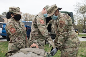 Members of the 459th Aeromedical Staging Squadron (ASTS) practice litter carrying techniques as part of annual training April 10, 2021. ASTS squadrons are responsible for stabilizing injured patients during ground transport between vehicles of opportunity and treatment facilities. (U.S Air Force photo by Staff Sgt. Anna-Kay Ellis)