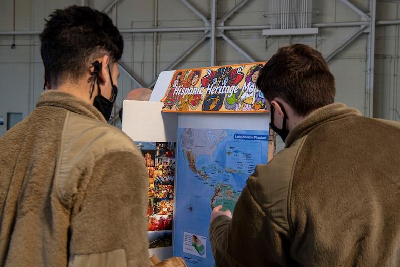 Airmen view a booth