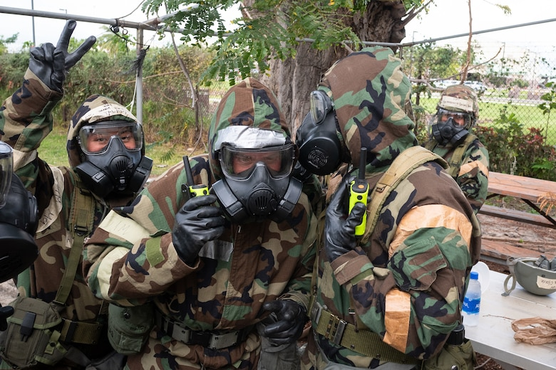 Airmen from the 154th Force Support Squadron, donned in personal protective equipment, conduct Chemical, Biological, Radiological, Nuclear and Explosive training February 23, 2021, at Joint Base Pearl-Harbor-Hickam, Hawaii.