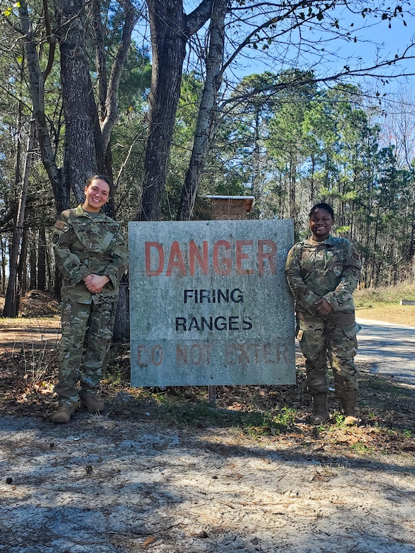 Senior Airman Sydney Lewandowski and Senior Airman Destiny Cooper train at the firing range at Joint Base Charleston, S.C. March 7, 2021. Training is an integral part of mission readiness and combat efficancy. Lewandowski is a Phoenix Raven and Cooper is a combat arms instructor and both are assigned to the 315th Security Forces Squadron.