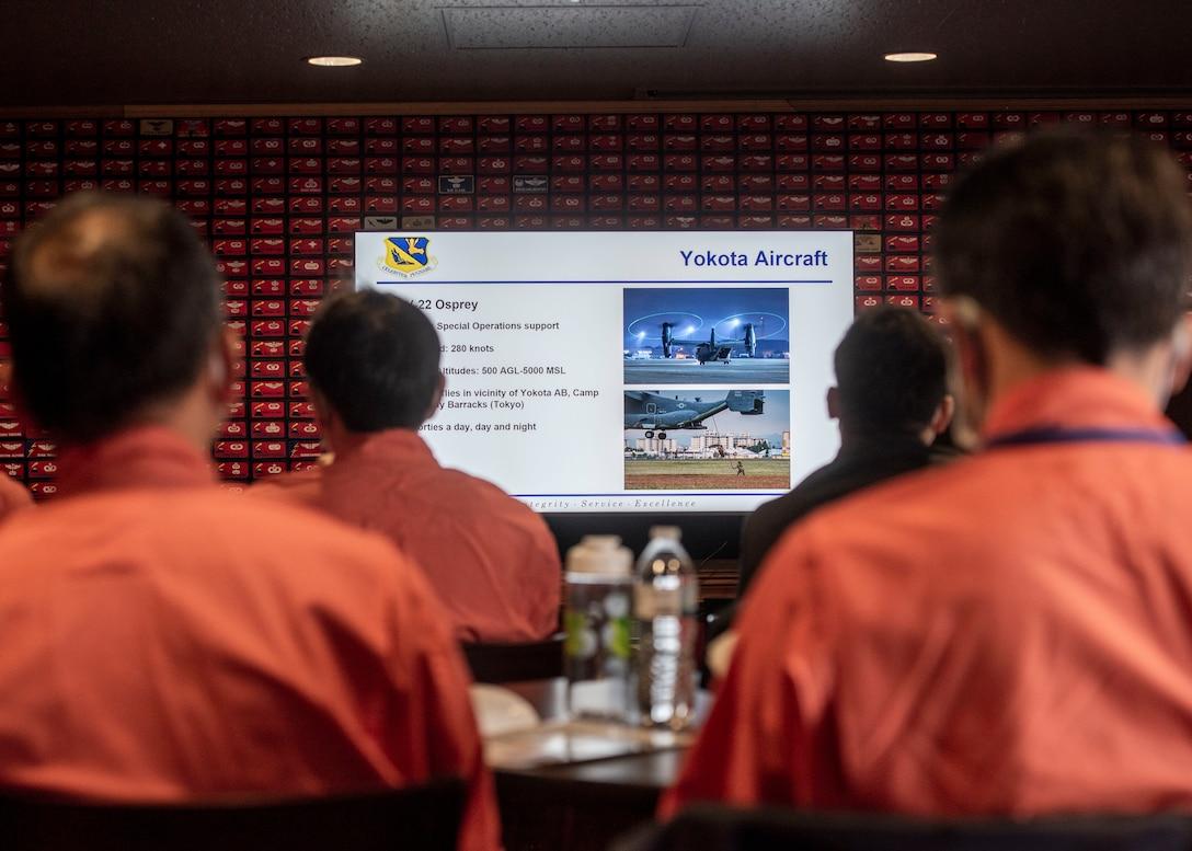 Tokyo Metropolitan Police and Japan Coast Guardsmen watch slideshow