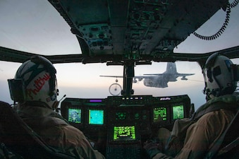 U.S. Marine Corps Capt. Ethan Hall, left, and Capt. Jacob Coffey, both MV-22 Osprey tiltrotor aircraft pilots assigned to Marine Medium Tiltrotor Squadron 164 (Reinforced), 15th Marine Expeditionary Unit (MEU), embarked with the amphibious assault ship USS Makin Island (LHD 8), perform tiltrotor air-to-air refueling (TAAR) with a U.S. Air Force MC-130H Combat Talon II aircraft, assigned to Air Force Special Operations Command, over the Arabian Gulf in support of Iron Defender 21.