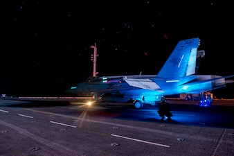 "An F/A-18E Super Hornet fighter jet, attached to the ""Wildcats"" of Strike Fighter Squadron (VFA) 131, prepares to launch from the flight deck aboard the aircraft carrier USS Dwight D. Eisenhower (CVN 69) in the Arabian Sea."