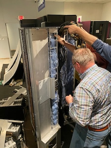 Electricians carefully move one of NSA's first supercomputers
