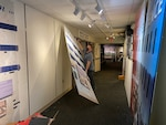 Museum Director Dr. Vince Houghton tears down old displays.
