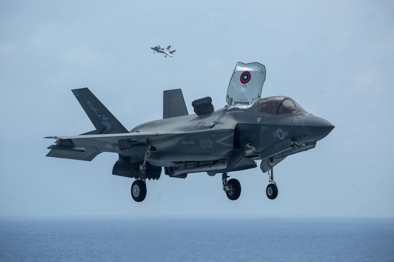 SOUTH CHINA SEA (April 8, 2021) – U.S. Marine Corps F-35B Lightning IIs assigned to Marine Medium Tiltrotor Squadron 164 (Reinforced), 15th Marine Expeditionary Unit, land on the flight deck of the amphibious assault ship USS Makin Island.
