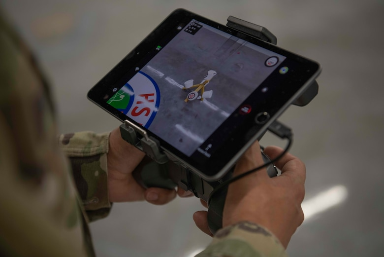 An Air Commando with the 1st Special Operations Civil Engineer Squadron learns how to fly an unmanned aircraft system at the FieldWerx Makerspace in Fort Walton Beach, Florida, April 6, 2021.