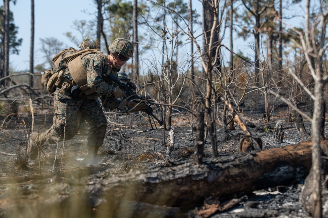 A Marine with Alpha Company, 1st Battalion, 6th Marine Regiment , 2d Marine Division, buddy rushes during a squad fire and maneuver training event on Camp Lejeune, N.C., April 7, 2021.
