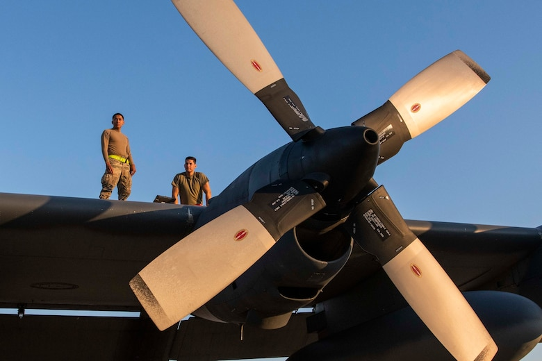 U.S. Air Force Airman 1st Class Jared Agustin, a fuels systems apprentice assigned to the 1st Special Operations Maintenance Squadron and U.S. Air Force Senior Airman Henry Rivas, a fuels system apprentice assigned to the 1st SOMXS inspect the wing of an MC-130H Combat Talon II at Hurlburt Field, Florida, April 5, 2021.