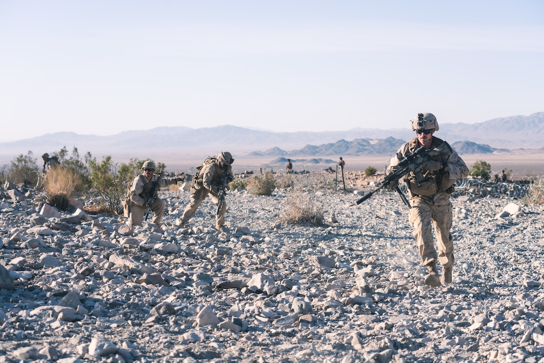 U.S. Marines with Company B, 1st Battalion, 5th Marine Regiment, make movement up the range during the Platoon Attacks at Range 410A while participating in Integrated Training Exercise (ITX), 3-21 at Marine Corps Air Ground Combat Center, Twentynine Palms, California, April 9, 2021. The purpose of ITX is to create a challenging, realistic training environment that produces combat-ready forces capable of operating as an integrated Marine Air Ground Task Force.  (U.S. Marine Corps photo by Lance Cpl. Andrew R. Bray)