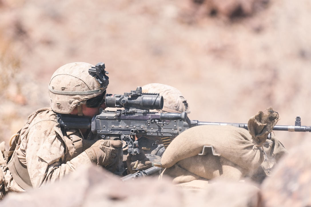 A U.S. Marine with Company B, 1st Battalion, 5th Marine Regiment, operates an M240B medium machine gun during the Platoon Attacks at Range 410A while participating in Integrated Training Exercise (ITX), 3-21 at Marine Corps Air Ground Combat Center, Twentynine Palms, California, April 9, 2021. The purpose of ITX is to create a challenging, realistic training environment that produces combat-ready forces capable of operating as an integrated Marine Air Ground Task Force.  (U.S. Marine Corps photo by Lance Cpl. Andrew R. Bray)